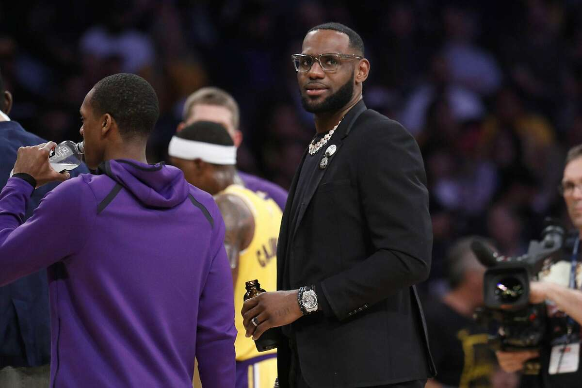 The Los Angeles Lakers' LeBron James on the bench in street clothes at the Staples Center in Los Angeles on April 9, 2019. (Gary Coronado/Los Angeles Times/TNS)