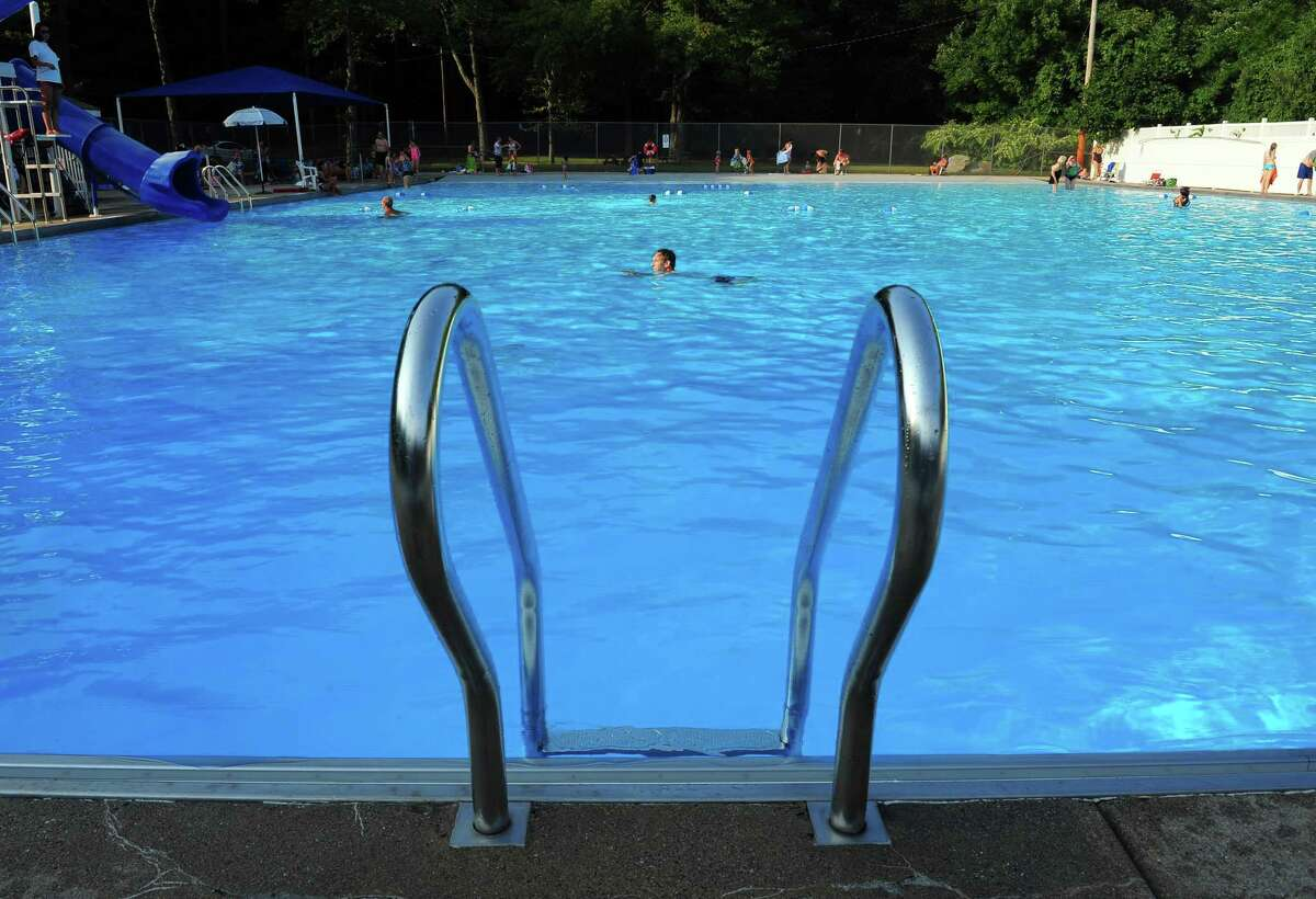 A swimmer makes his way across the pool at Robert G. Beach Memorial Park in Trumbull, Conn., on Wednesday Sept. 2, 2015. The pool, and the one at Tashua Knolls, will reopen on a limited basis July 6.