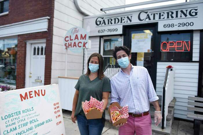 Business owners Tina Carpenteri and Frank Carpenteri Jr. show lobster rolls for sale at the new Clam Shack outside Garden Catering in Old Greenwich. The outdoor stand will be open Thursdays through Sundays in the summer, serving a variety of seafood and fried food.