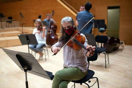 Members of the Barcelona Symphony and Catalonia National Orchestra wear face masks during a rehearsal in Barcelona on June 16.