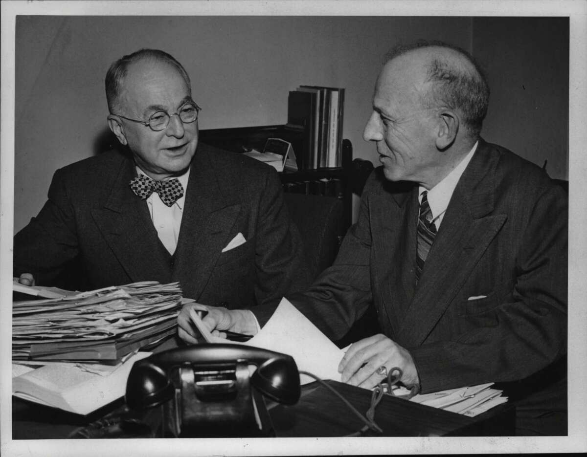 Solicitor General Wendell P. Brown, left, confers in April 1951 with special prosecutor John M. Minton about arrangements for the forthcoming grand jury probe of gambling in and near Saratoga Springs. (Times Union Archive)