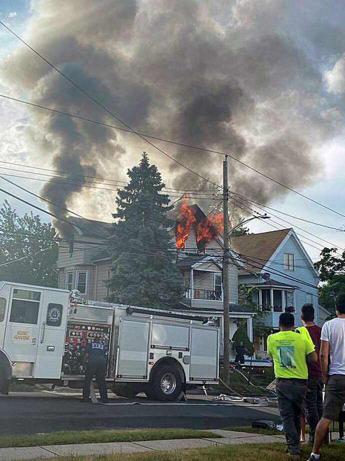 A fire at a 2.5-story home at 176 Beacon Ave. in New Haven, Conn., on Wednesday, July 1, 2020, according to the New Haven Fire Twitter. Photo: Contributed Photo / Carissa Anastasio Via New Haven Fire Twitter