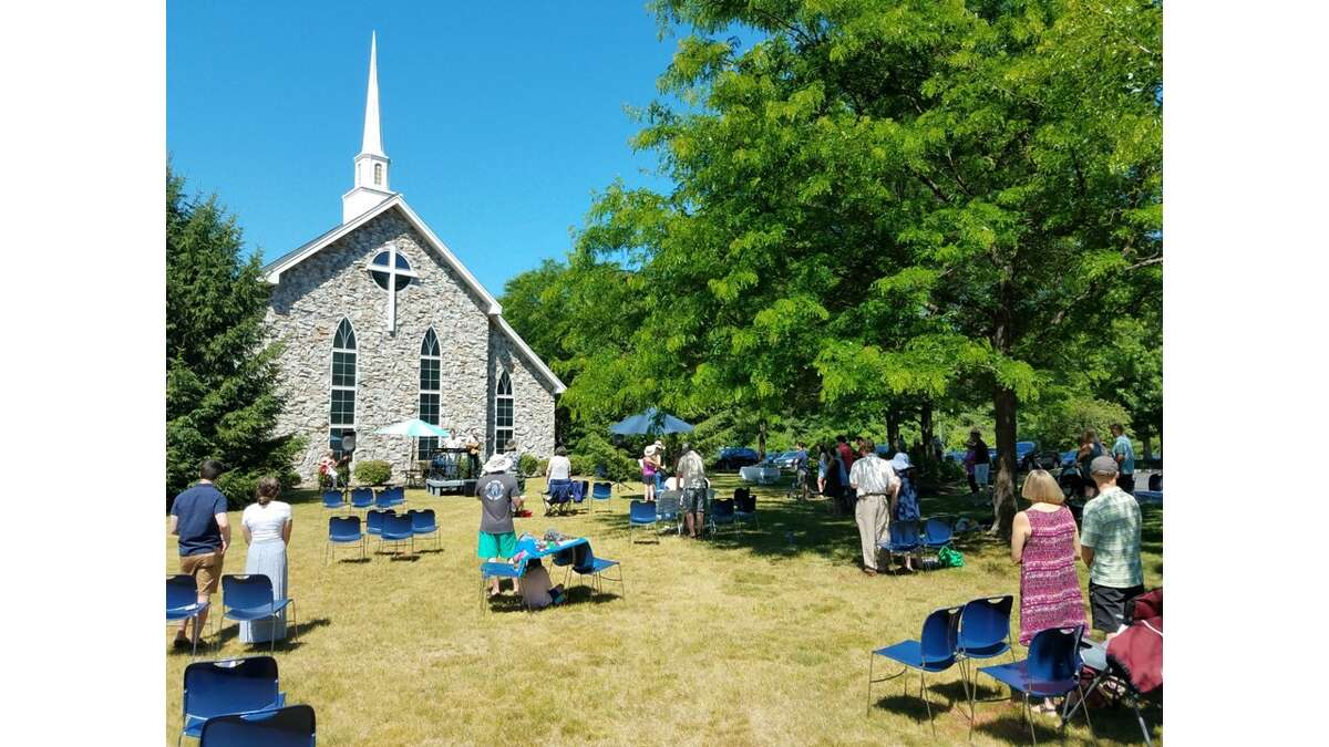 Grace Chapel in Clifton Park is now holding its service outdoors on the front lawn, and this is what it looked like on Father's Day. Jim LaBate of Clifton Park.