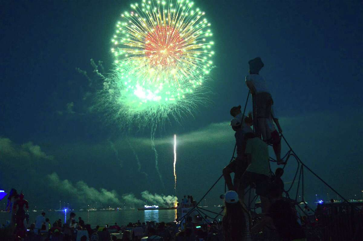 Skyrockets light up the sky over Long Island Sound at the 2017 Independence Day Fireworks Fundraising Show at Compo Beach, Monday, July 3, in Westport, Conn.