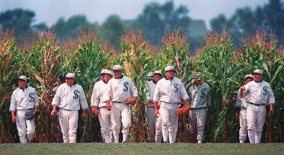 "In this file photo, people portraying ghost players emerge from a cornfield as they reenact a scene from the movie ""Field of Dreams"" at the movie site in Dyersville, Iowa. Work continues on building a field on the movie site for a game. Originally, the Yankees were to face the White Sox. However, it appears to Cardinals will replace the Yankees and play the White Sox if the game takes place. Photo: AP Photo"