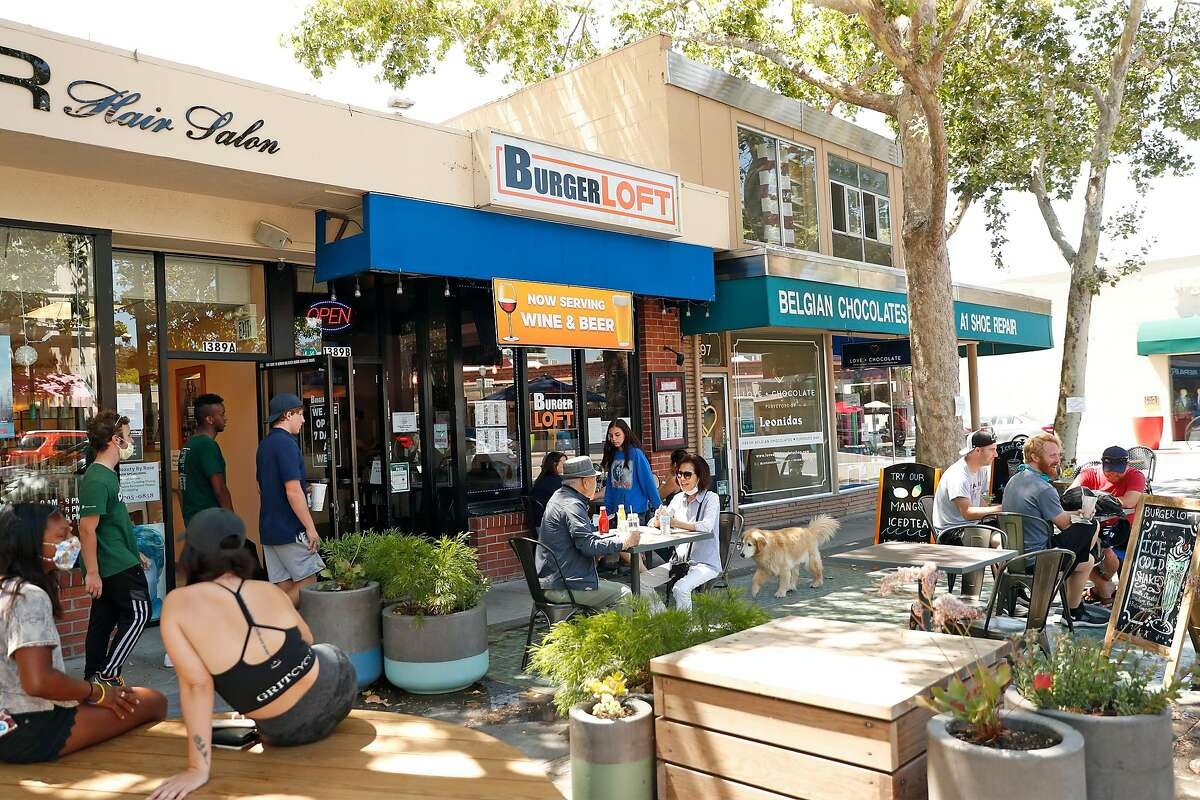 Diners fill tables outside Burger Loft on Main Street in Walnut Creek, Calif., on Wednesday, July 1, 2020. Earlier on July 1st, California Governor Gavin Newsom announced new shutdowns of restaurants and other indoor businesses in 19 counties including Contra Costa County.