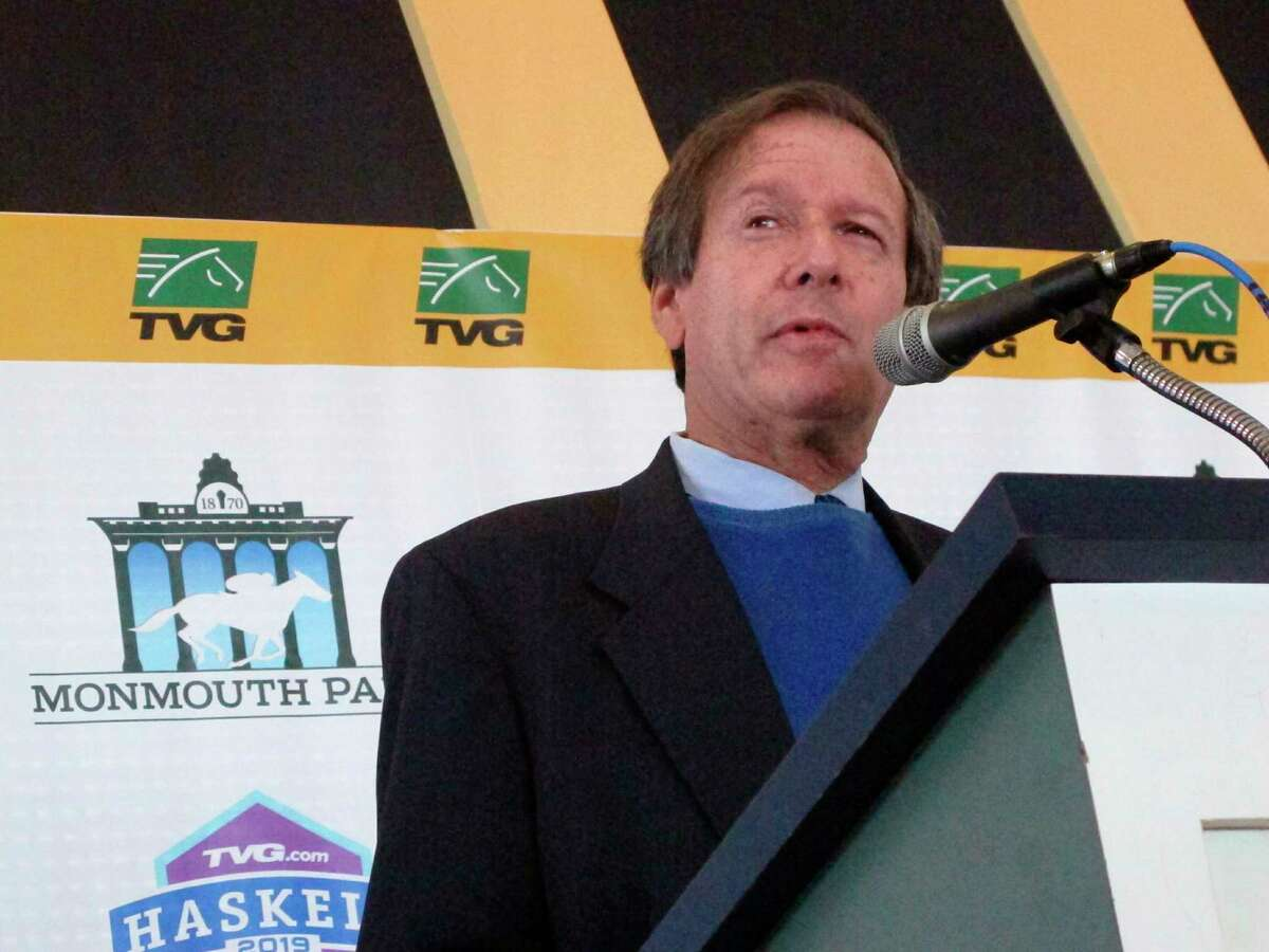 FILE - In this May 7, 2019, file photo, Dennis Drazin, the chief executive and chairman of Darby Development LLC, which operates Monmouth Park Racetrack, speaks at a press conference at the Oceanport, N.J. With the opening of the thoroughbred season at Monmouth Park just days away, chief executive Dennis Drazin knows the track will be beating the odds by just breaking even. The coronavirus pandemic has idled the New Jersey Shore track for two months. (AP Photo/Wayne Parry, File)