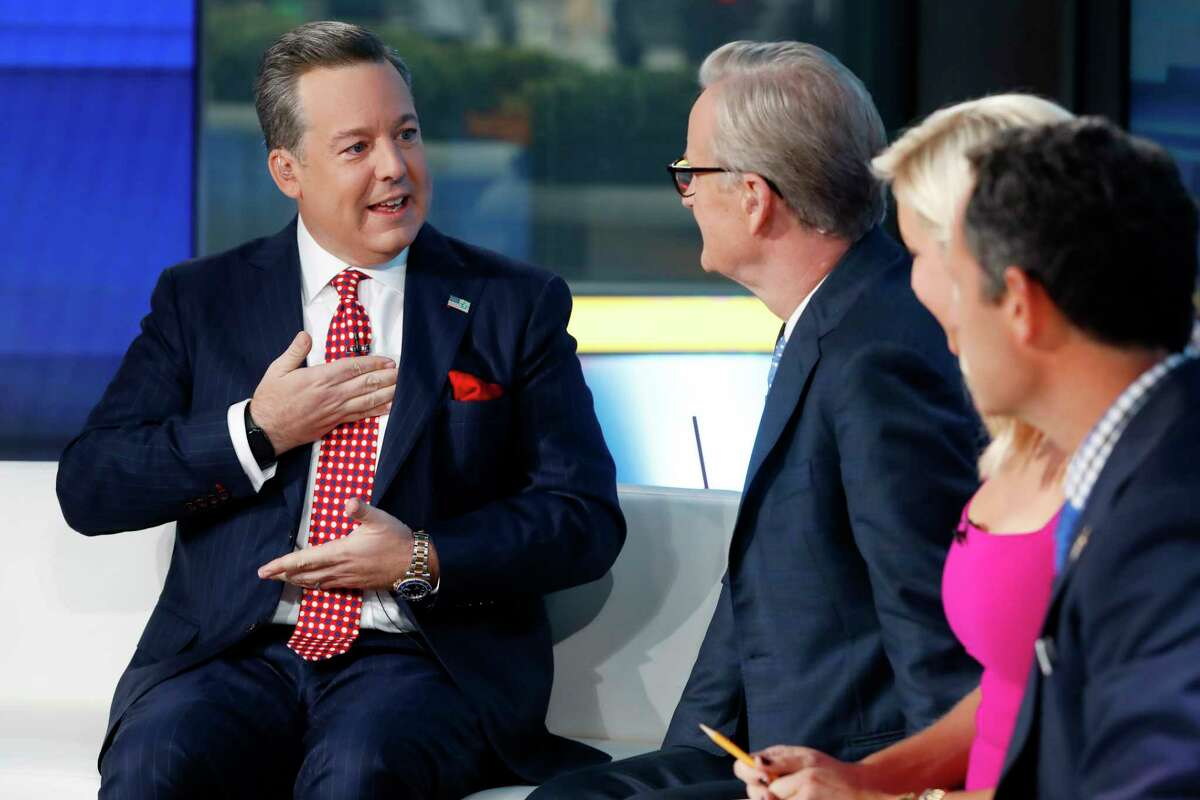 FILE - Fox News Chief National Correspondent Ed Henry, left, appears with co-hosts Steve Doocy, second left, Ainsley Earhardt, and Brian Kilmeade on the