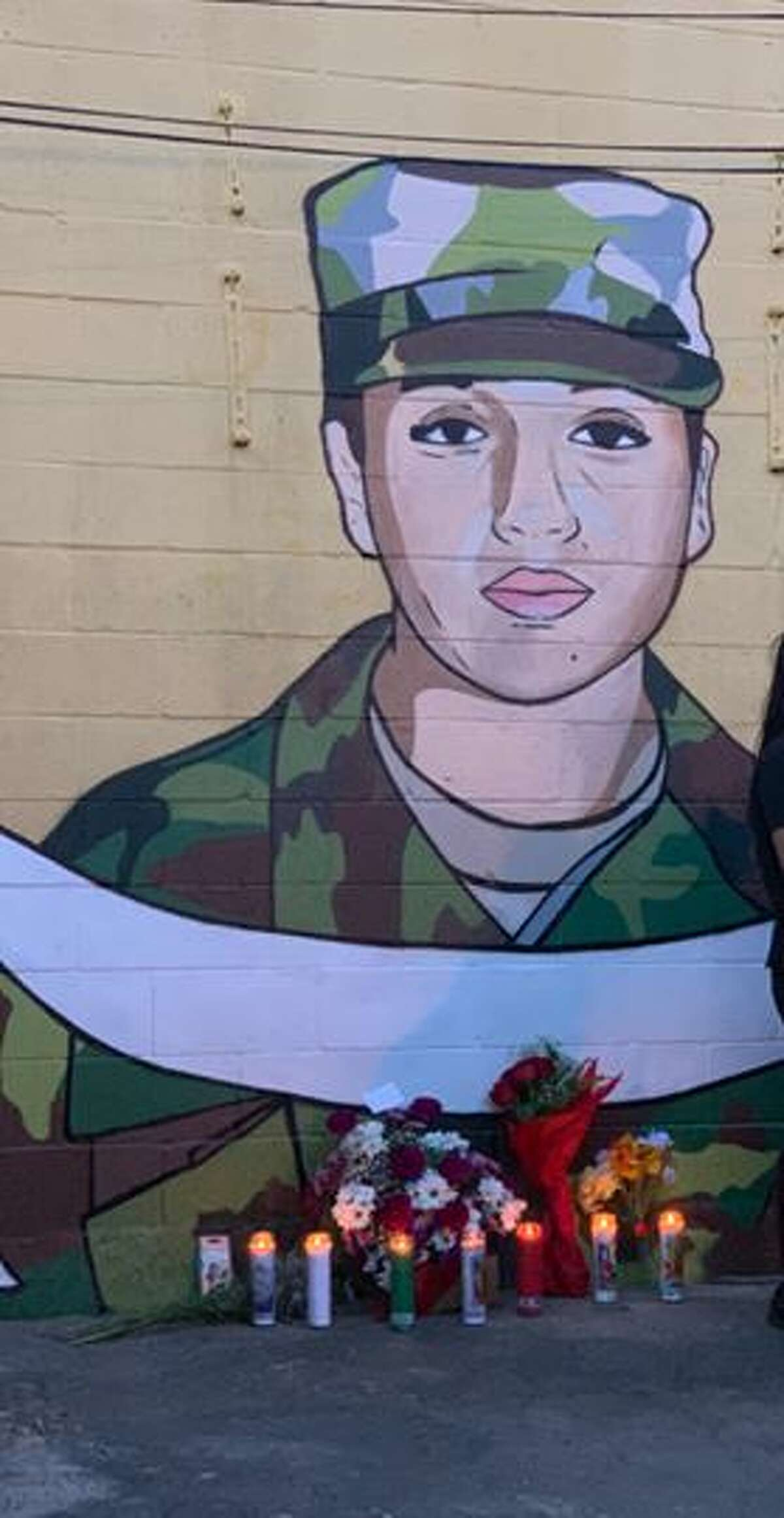 Crowds gathered around the finished mural at Taqueria del Sol holding a candlelight vigil in honor of Pfc. Vanessa Guillen on Wednesday,July 1.