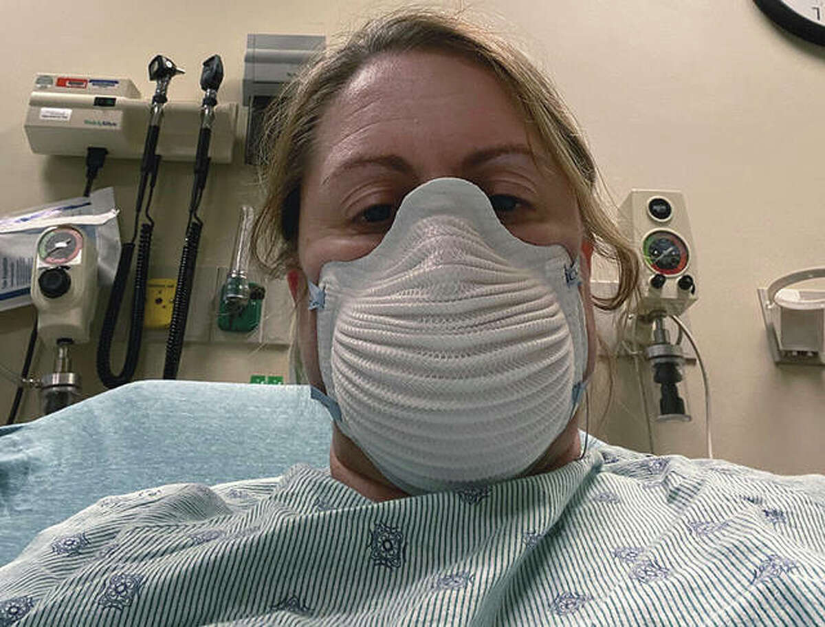 Jennifer Gottschalk is tested for COVID-19. As an environmental health supervisor for a health department, she fielded calls about COVID-19 cases from a hospital bed while fighting the disease herself. She then worked throughout her home isolation, stopping only when her coughing was too severe to talk.