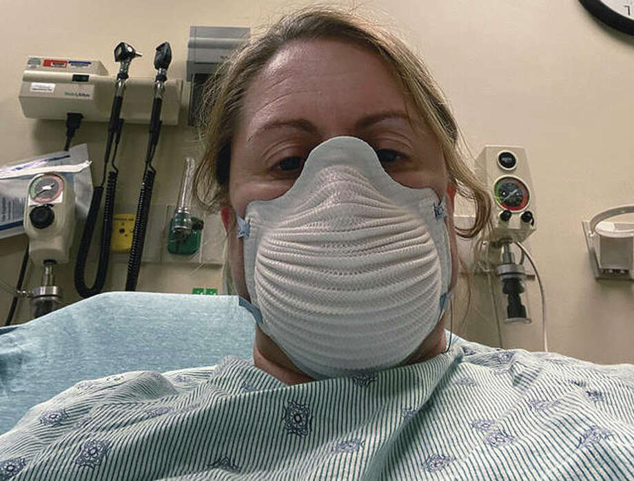 Jennifer Gottschalk is tested for COVID-19. As an environmental health supervisor for a health department, she fielded calls about COVID-19 cases from a hospital bed while fighting the disease herself. She then worked throughout her home isolation, stopping only when her coughing was too severe to talk. Photo: Jennifer Gottschalk | Via AP