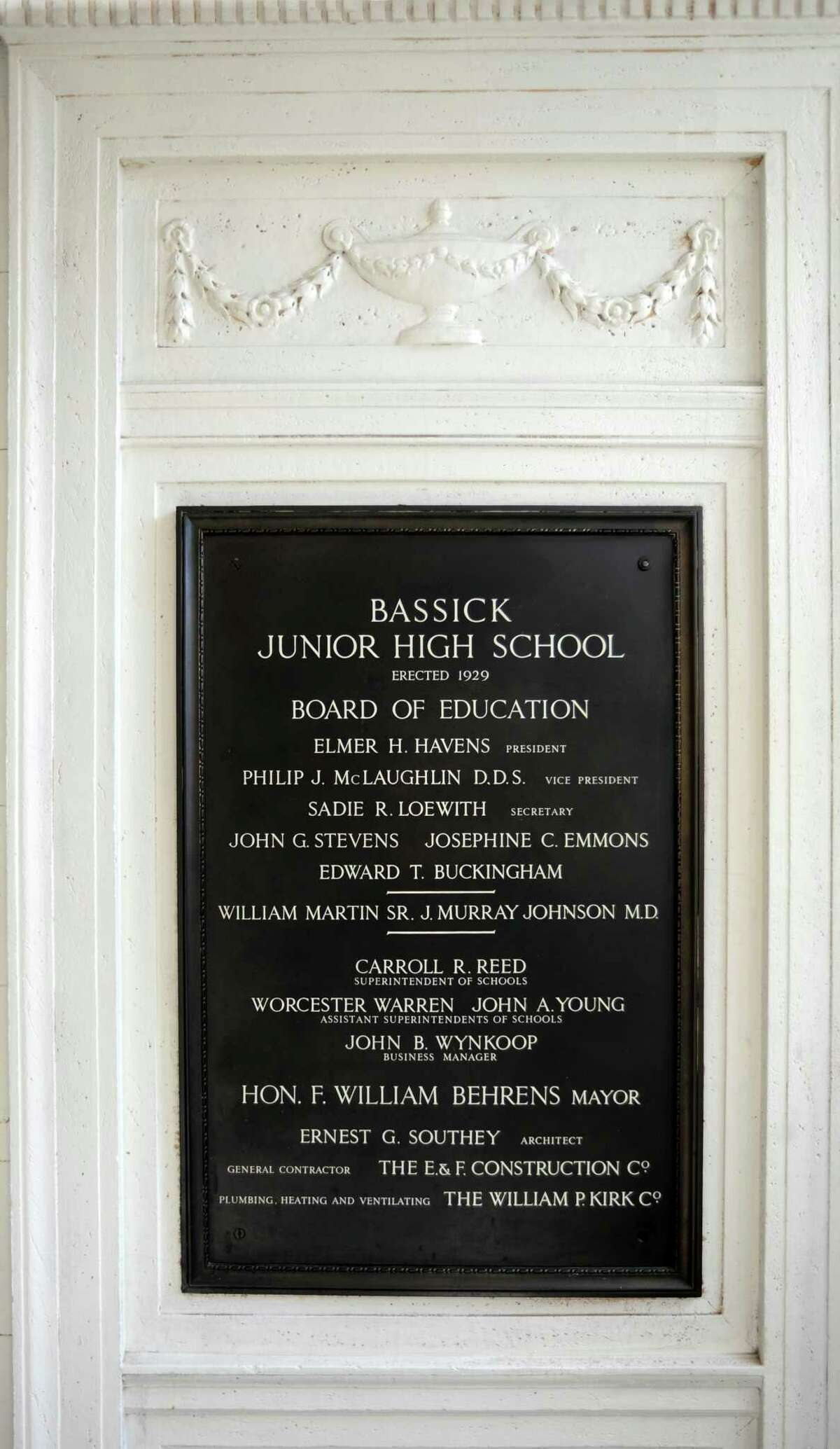 a plaque inside the entrance to Bassick High School in Bridgeport, Conn. on Thursday, August 24, 2017, lists the administrators whenthe building housed Bassick Junior High School, erected 1929.