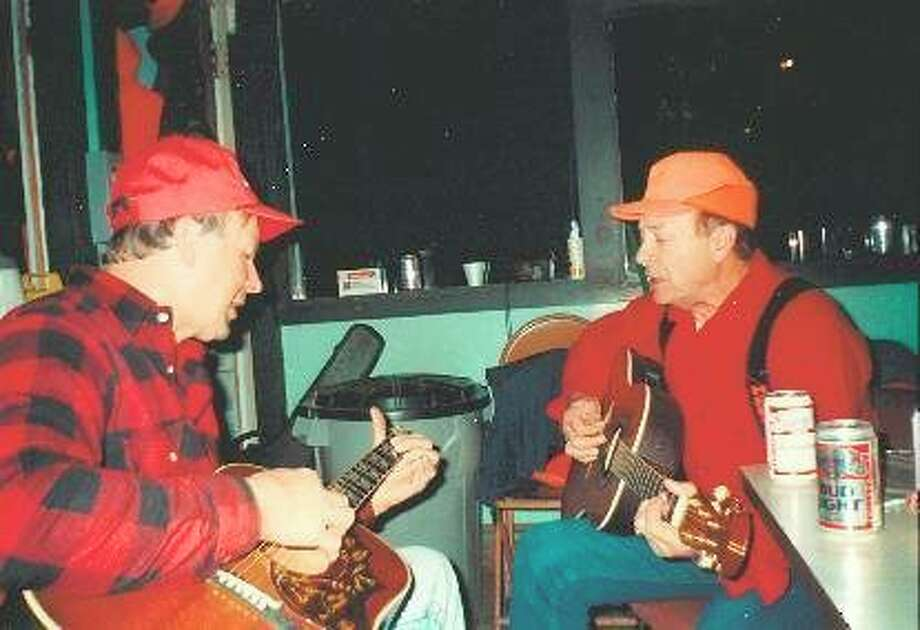 Harold, left, and Ollie play guitars during deer season. Today, only Harold, Ollie and their sister Joanne Kuehne remain to remember what it as like to be the children of Mike and Mary Leigeb.