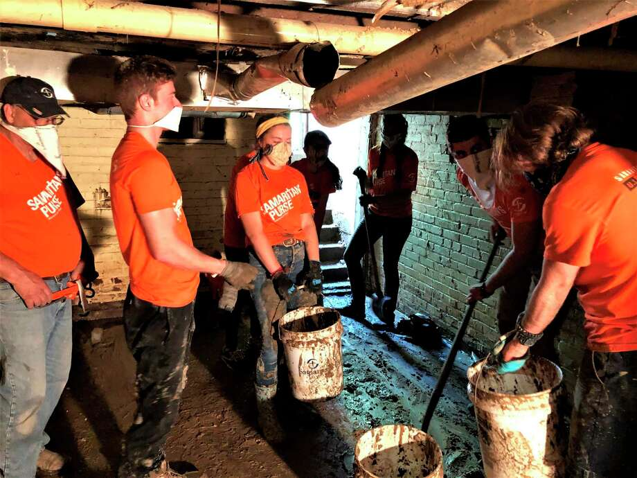 Volunteers with Samaritan's Purse help clean out a flooded home. (Photo provided/Samaritan's Purse and Billy Graham Evangelistic Association)