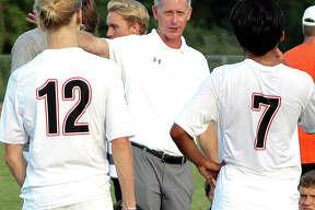 Edwardsville coach Mark Heiderscheid gives his team instructions during a game last season at Alton High School.