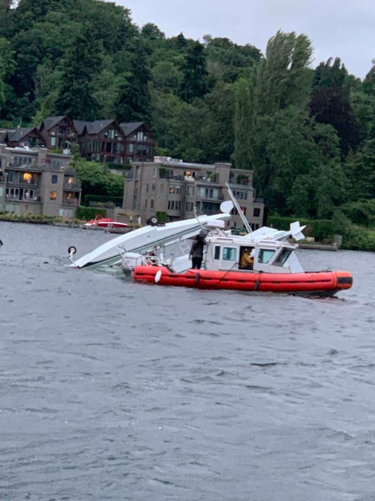 Two people rescued by nearby kayakers after seaplane crashes into Lake Washington