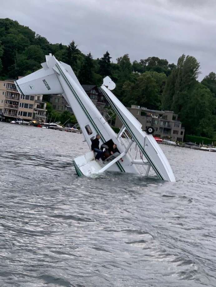 Two people rescued by nearby kayakers after seaplane crashes into Lake Washington Photo: Alex Flaco