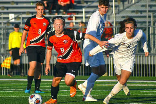 Edwardsville's Cooper Nolan in action during a Class 3A regional semifinal game against Granite City inside the District 7 Sports Complex.