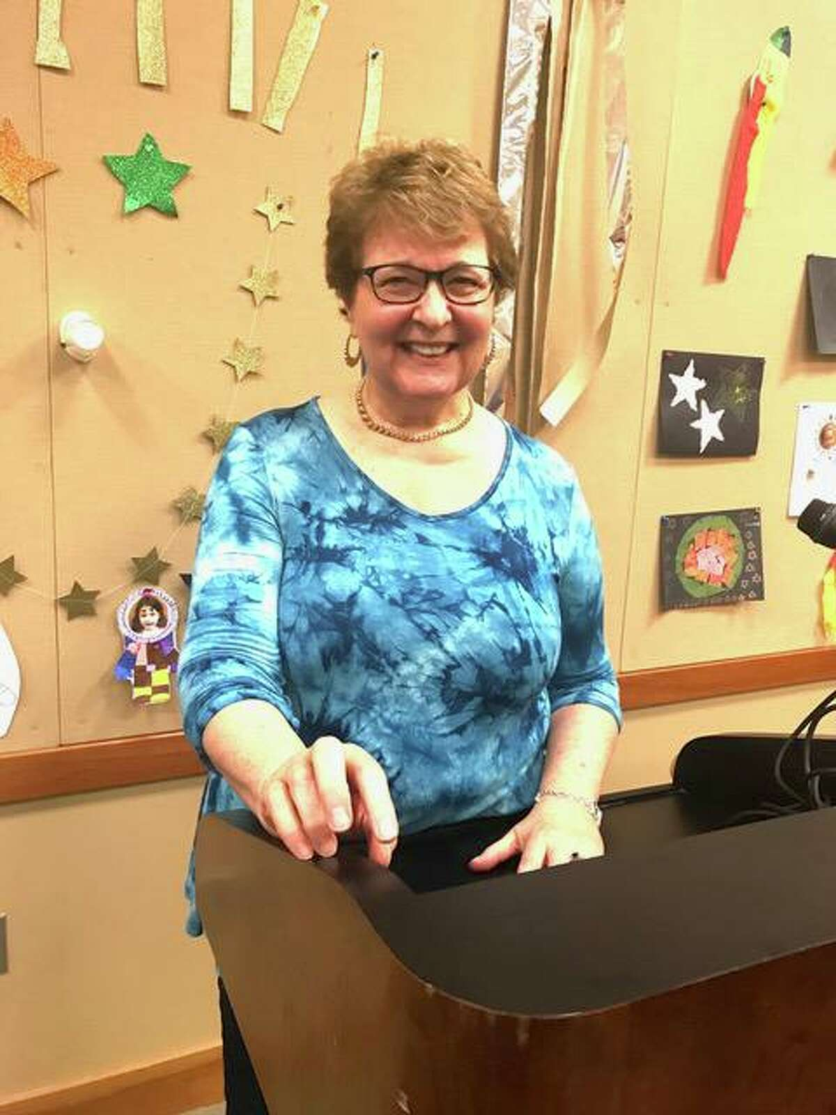 Diane Tunick Morello hosts an Open Mic event at the Cos Cob Library