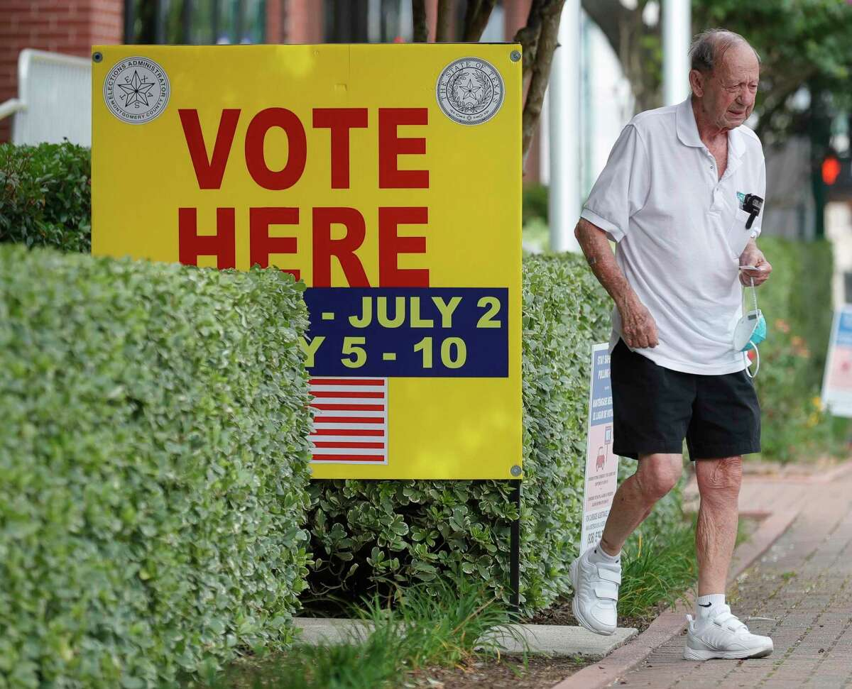 A man carries a facemask as he leaves the Lee G. Alworth Building during the second day of early voting, Tuesday, June 30, 2020, in Conroe. Early voting for the run-off elections for chief justice of the 9th Court of Appeals, Precinct 2 Constable and judge of the newly created 457th state District Court runs through July 10. Election Day is July 14.