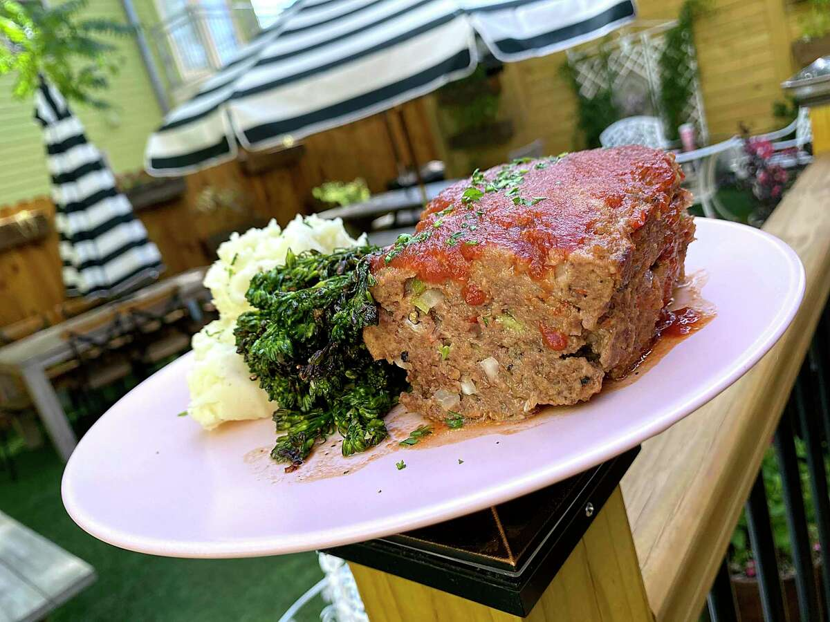 Meatloaf comes with mashed potatoes and broccolini at the new Tutti's A Place for Foodies, one of five great places to get meatloaf to comfort us during the COVID-19 pandemic.