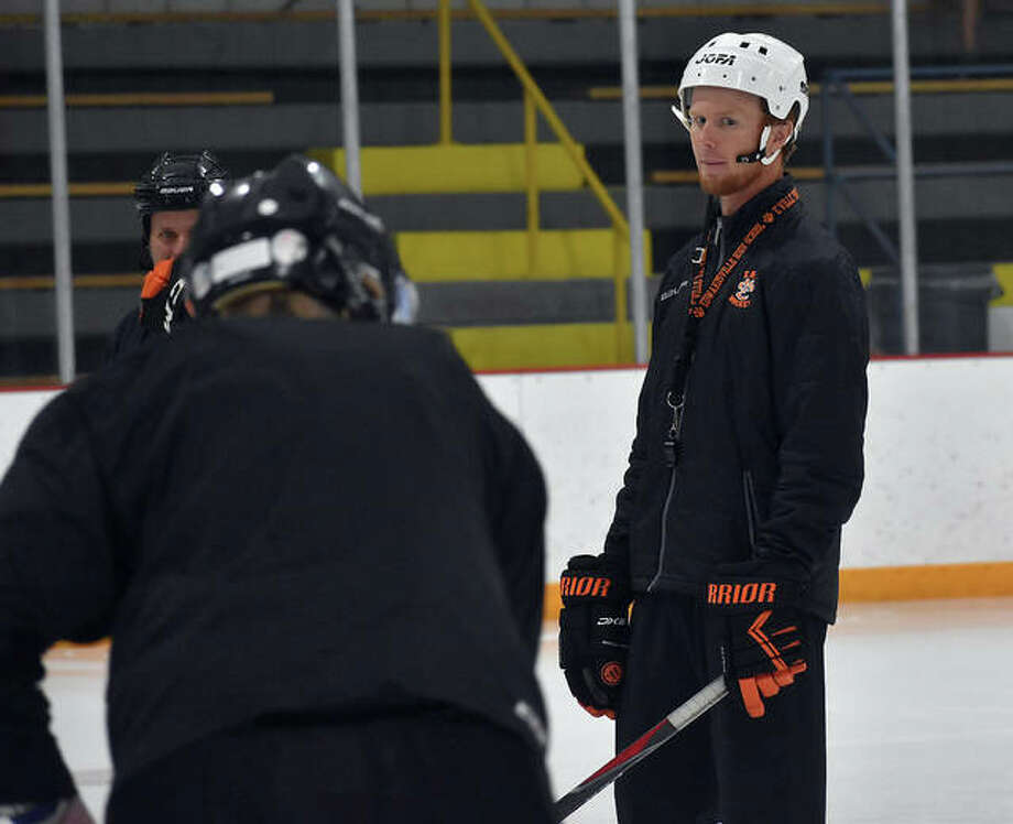 Edwardsville coach Jason Walker watches a skater complete a drill during Wednesday's conditioning session inside the East Alton Ice Arena. Photo: Matt Kamp|The Intelligencer