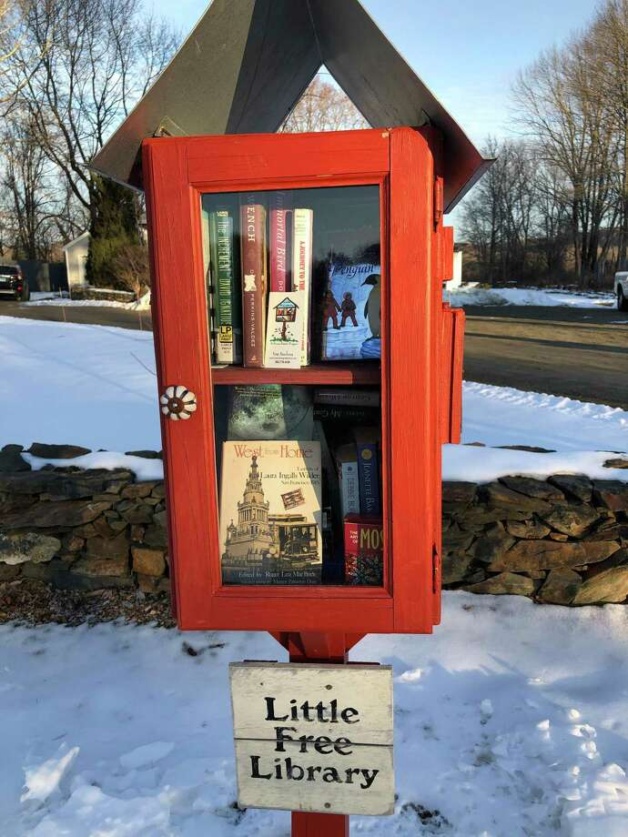 A Little Free Library, filled and ready for borrowing and lending. Photo: Rose Buckens / Contributed Photo