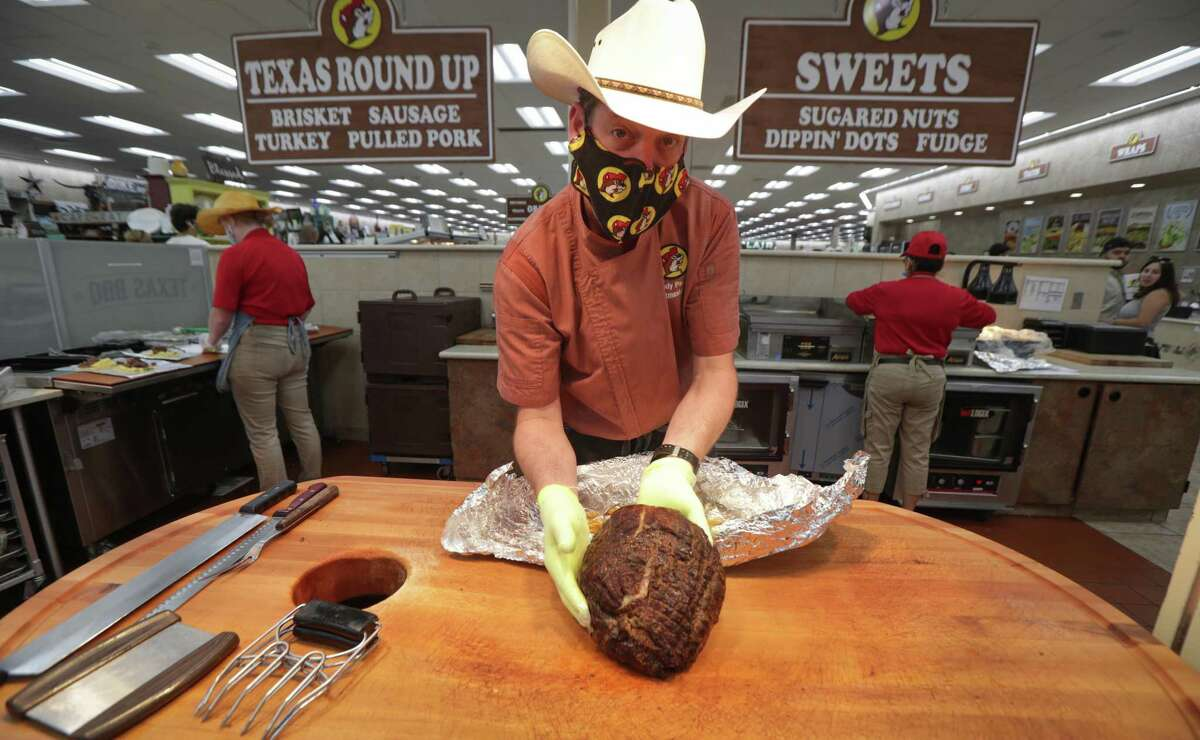 Buc-ee's Pitmaster Randy Pauly works on making pulled pork meat for sandwiches Friday, June 19, 2020, in Katy.