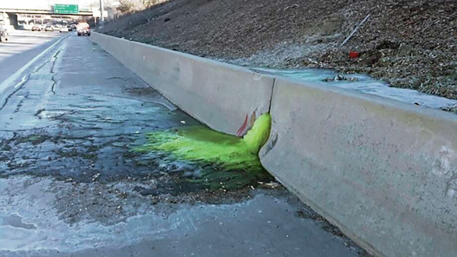 FILE - This Dec. 20, 2019 file photo provided by Michigan Department of Transportation shows toxic chemical substances leaking along Interstate 696 in Madison Heights, Mich. An industrial site in suburban Detroit where a bright green goo seeped through a concrete barrier onto an area freeway is subject to forfeiture due to non-payment of property taxes. Five properties tied to Electro-Plating Services Inc. in Madison Heights owe a total of more than $30,000 in taxes, interest and fees from 2017 and 2018, according to the Oakland County Treasurer's office.(Michigan Department of Transportation via AP, File) Photo: AP