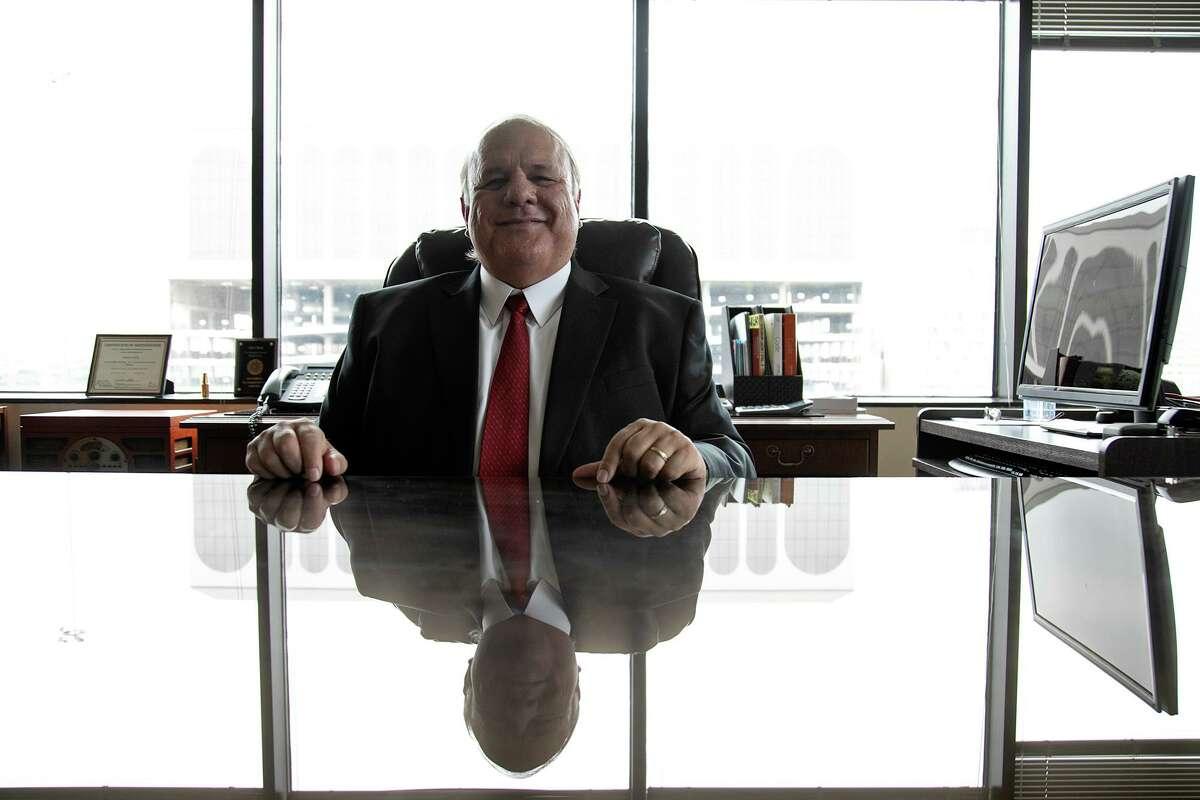 Bexar County Tax-Assessor Collector Albert Uresti at his desk.