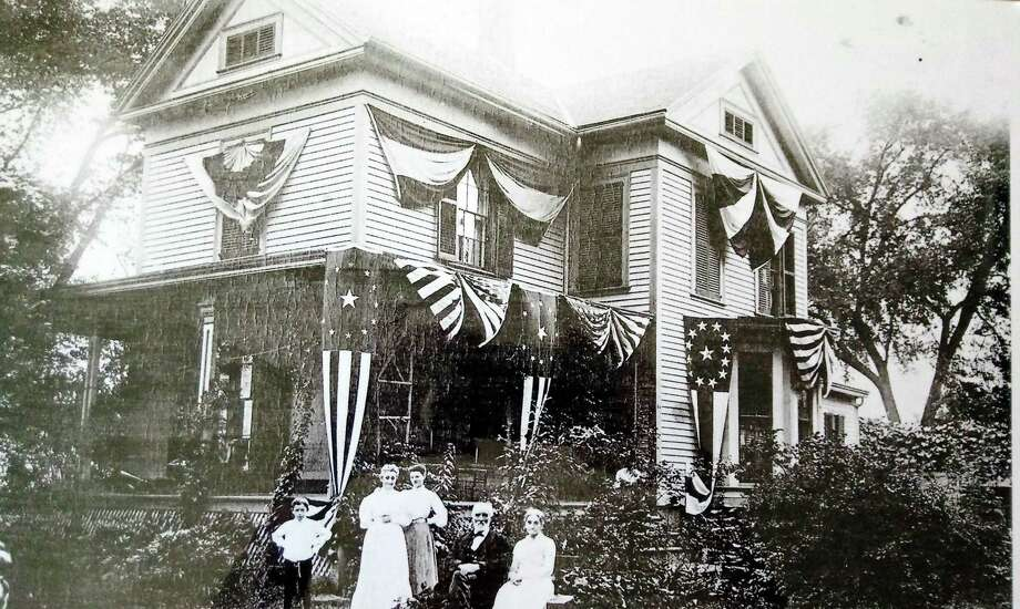 A house in North Guilford showing the patriotic enthusiasm displayed around the turn-of-the-century. Photo: Contributed