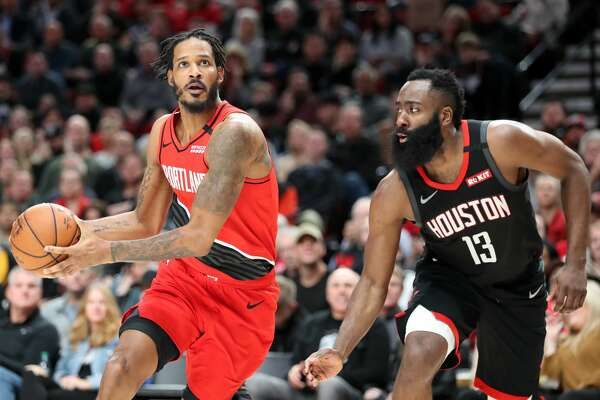 PORTLAND, OREGON - JANUARY 29: Trevor Ariza #8 of the Portland Trail Blazers dribbles against James Harden #13 of the Houston Rockets in the second quarter during their game at Moda Center on January 29, 2020 in Portland, Oregon. NOTE TO USER: User expressly acknowledges and agrees that, by downloading and or using this photograph, User is consenting to the terms and conditions of the Getty Images License Agreement. (Photo by Abbie Parr/Getty Images)