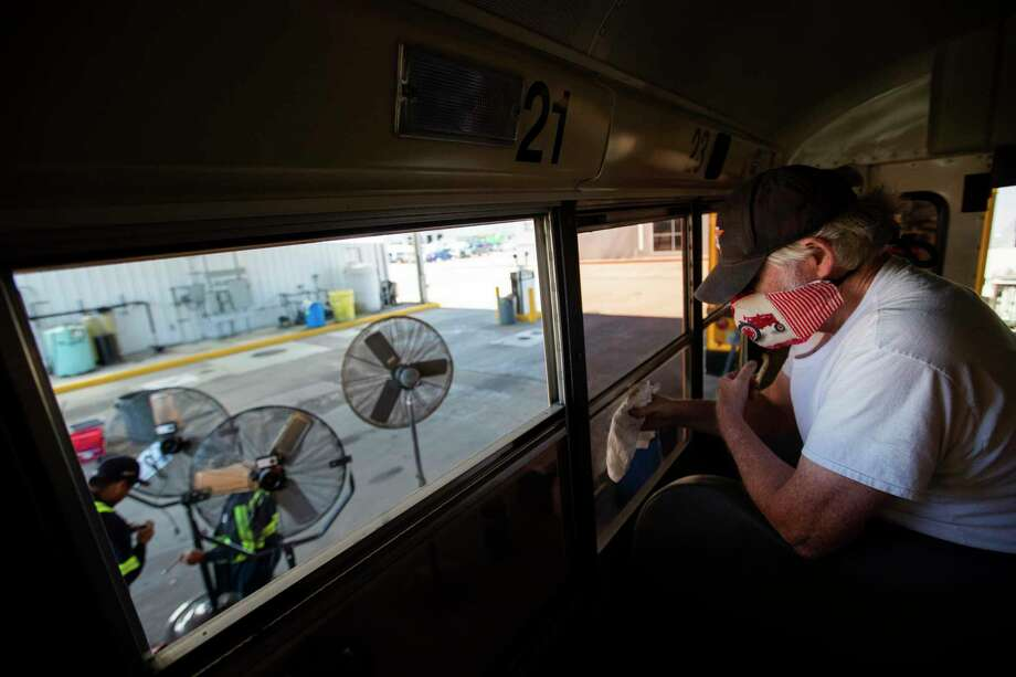Humble ISD bus driver Pat Haudhton disinfects the windows of a Humble ISD school bus on Thursday, June 11, 2020, in Humble. Photo: Marie D. De Jesús, Houston Chronicle / Staff Photographer / © 2020 Houston Chronicle