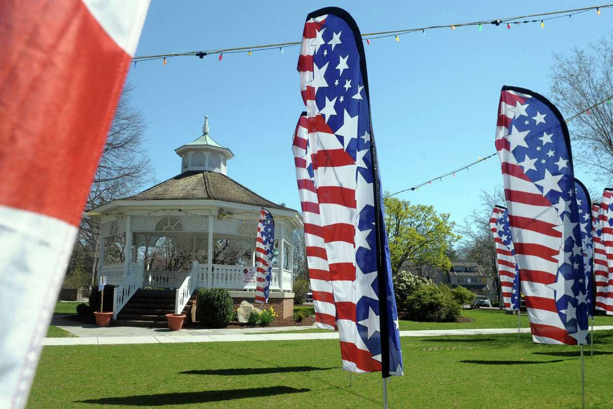 American flag banners were in place around the Sherman Green gazebo. They were removed and have been replaced with actual flags.