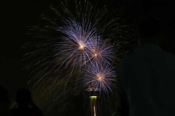 In 2014, residents take in the July 4 fireworks downtown. Many official fireworks shows have been canceled this year, but a reader sees financial opportunity for the city in  unofficial ones.