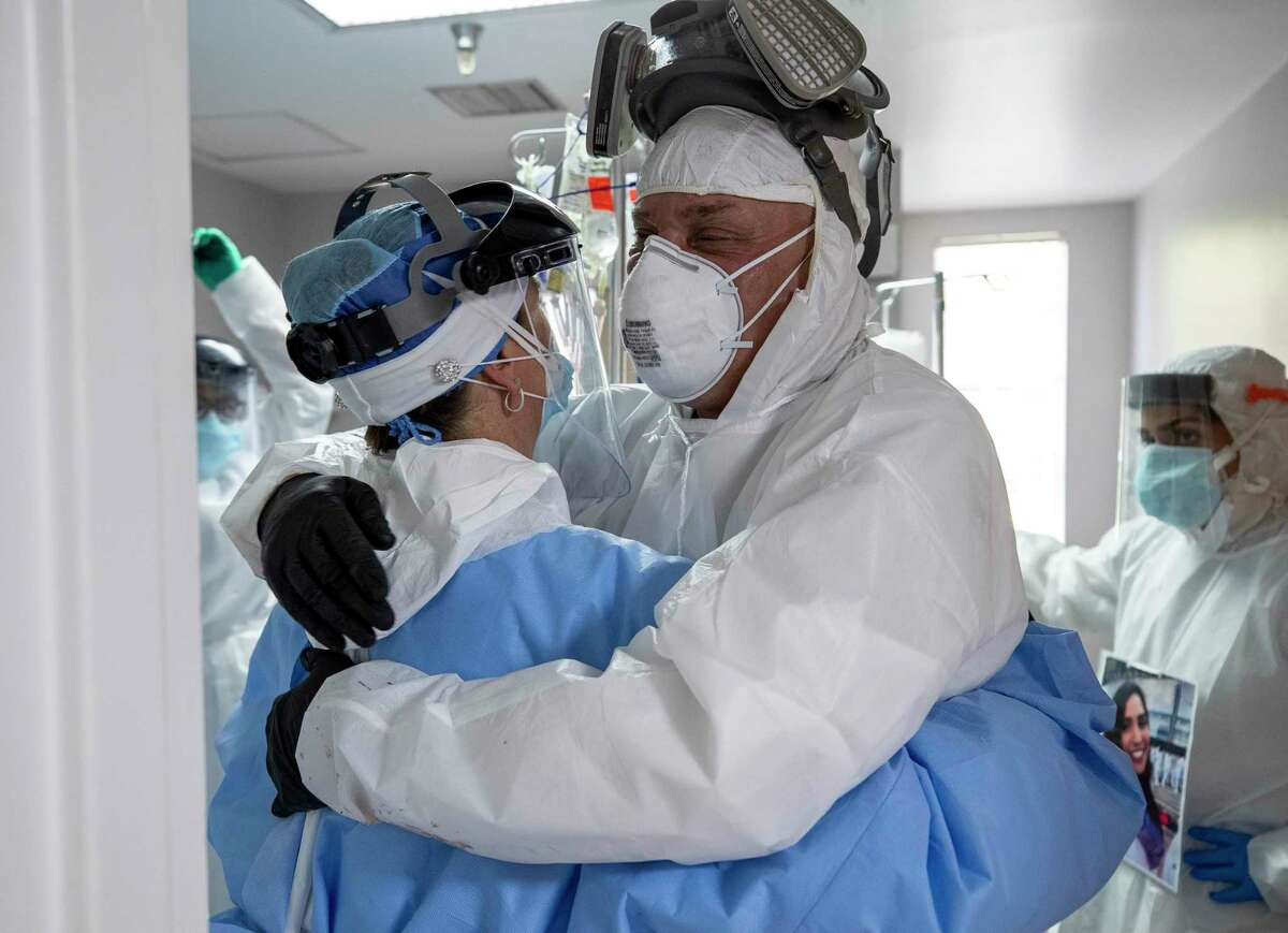 A doctor and nurse in Houston hug this summer after establishing a dialysis line for a COVID-19 patient. A reader extends gratitude to all the front-line workers who have kept us going throughout the pandemic.
