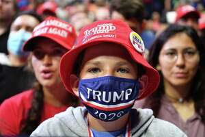 A young supporter wears a Trump 2020 mask as he listens to President Donald Trump in Tulsa, Okla. But the president has largely resisted masks and so have many of his supporters. For the good of America, this needs to change.