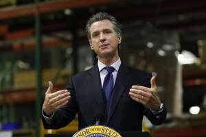 In this photo taken Friday, June 26, 2020, Gov. Gavin Newsom speaks about the coronavirus pandemic as he gives an update on the state's response to it at a news conference in Rancho Cordova, Calif. Newsom issued his sharpest warning yet about the rising coronavirus threat and announced for the first time that the state had asked a county to shut back down, pleaded with Californians to wear masks and reminded them that dozens of people are dying each day. (AP Photo/Rich Pedroncelli, Pool)
