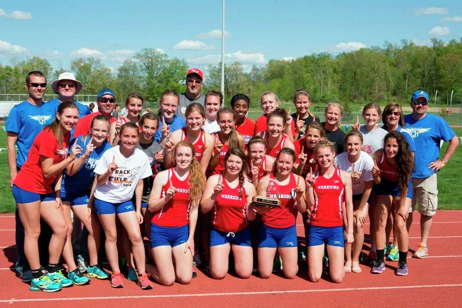 The 2014 Chippewa Hills girls' track and field team took home both the D2 MITCA and D2 MHSAA State titles. (Courtesy photo)