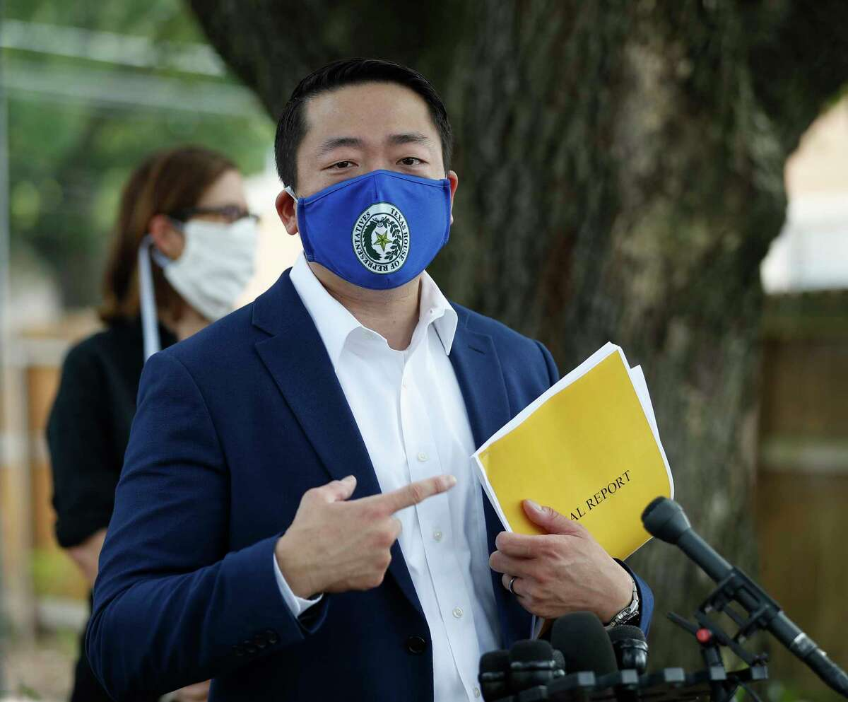 State Rep. Gene Wu, points to his copy of an HPD report, as he spoke to the media, along with other lawmakers, to address the HPD Narcotics Division audit, Thursday, July 2, 2020, in Houston, in front of the home where Rhogena Nicholas and Dennis Tuttle, were killed on Harding Street.