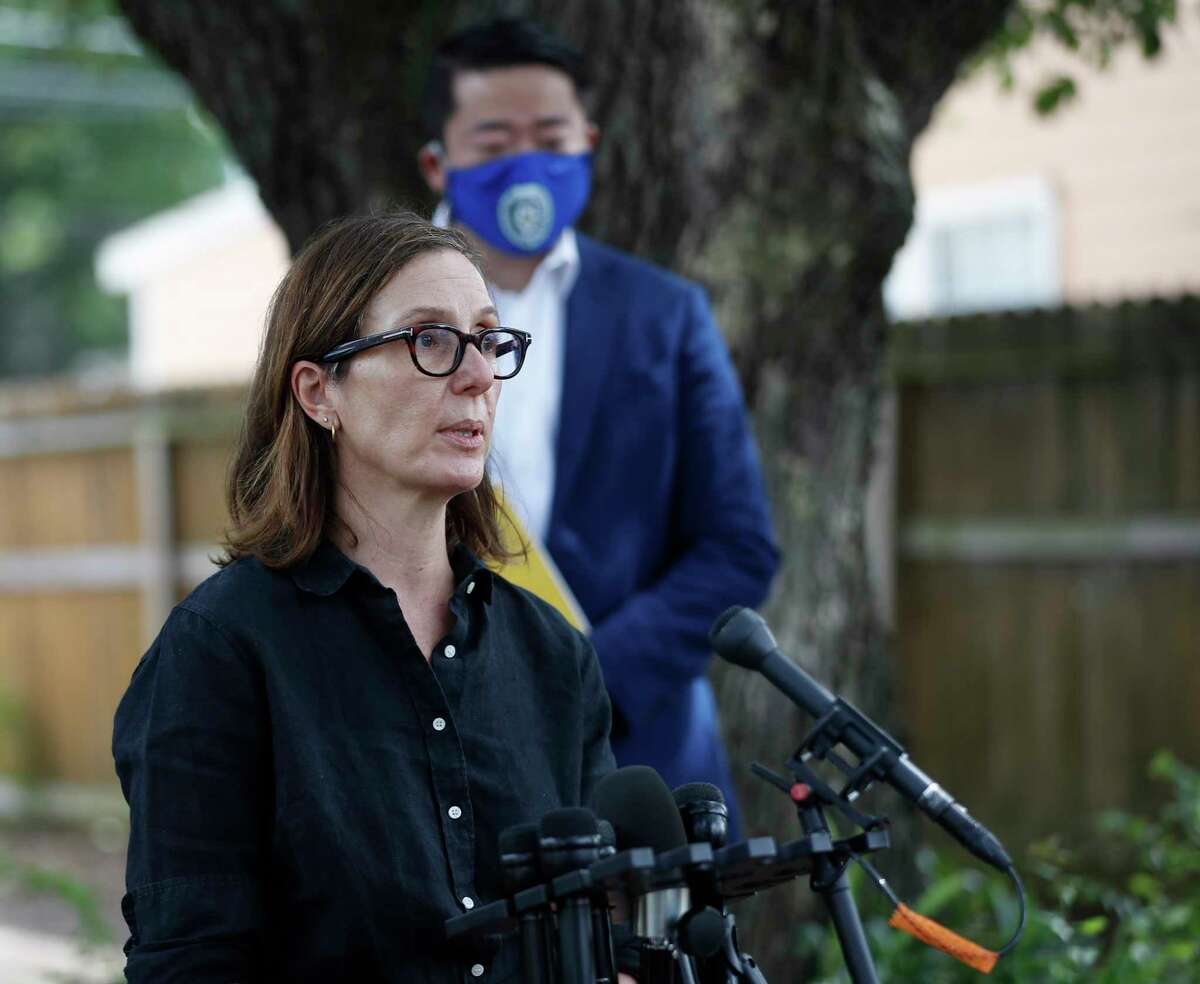 Representative Anna Eastman speaks to the media with State Rep. Gene Wu and other lawmakers to address the HPD Narcotics Division audit, Thursday, July 2, 2020, in Houston, in front of the home where Rhogena Nicholas and Dennis Tuttle, were killed on Harding Street.