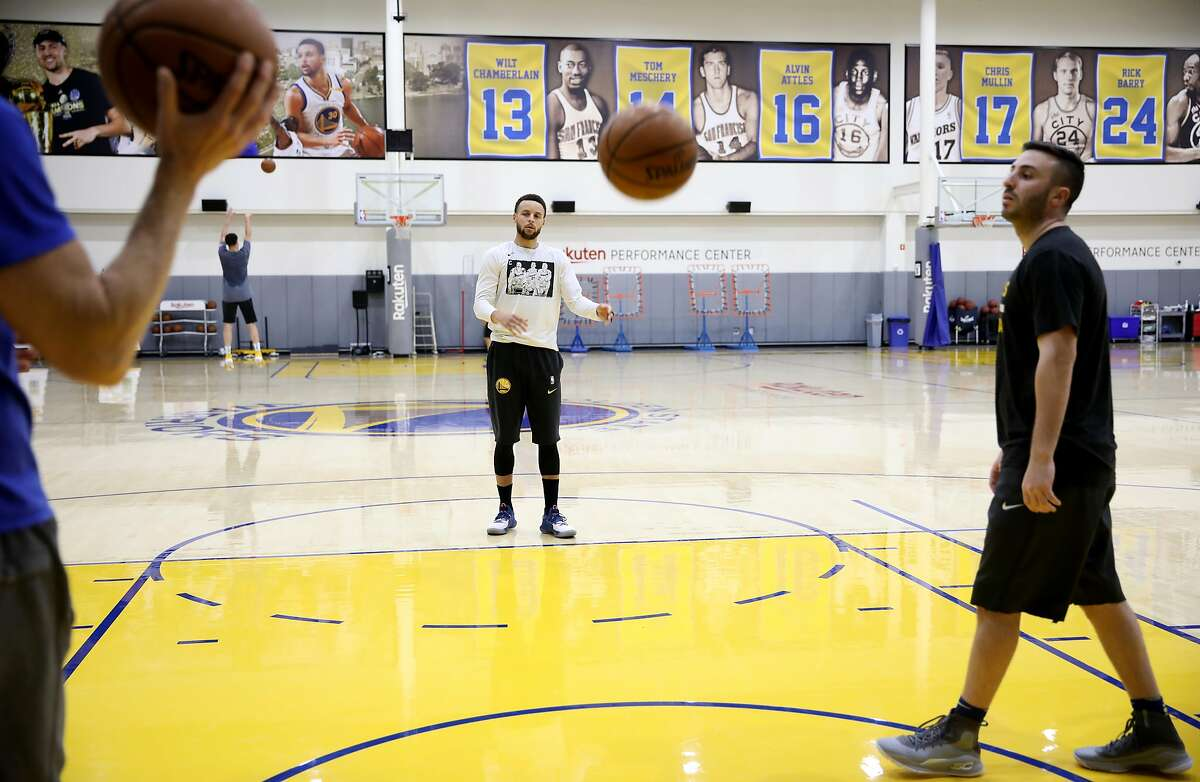 Golden State Warriors point guard Steph Curry shoots free throws during basketball practice at the Rakuten Performance Center in Oakland, Calif., in May.