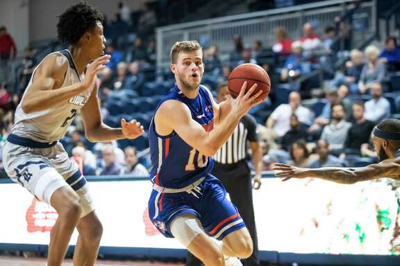 Houston Baptist Ty Dalton (10) pulls up for a shot while being defended by Rice guard Trey Murphy (2) in the second half of a college basketball game Saturday, Dec 14, 2019, in Houston.