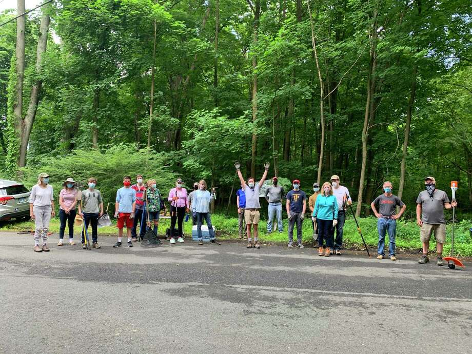 A group of volunteers cleaned up Comstock Hill Cemetery — final resting place of seven Revolutionary War soldiers — this past June. Another clean-up day is planned for Sunday, Nov. 8. Photo: Contributed Photo / Wilton Conservation Land Trust / Wilton Bulletin Contributed