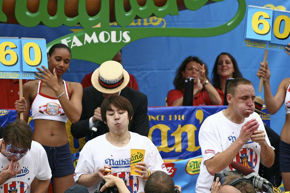 Takeru Kobayashi of Nagano, Japan and Joey Chestnut of Chicago, IL compete at Nathan's Famous July Fourth International Hot Dog eating contest at Nathan's famous restaurant in Brooklyn's Coney Island, New York on July 4, 2007. Kobayashi and Chestnut had a famous rivalry.