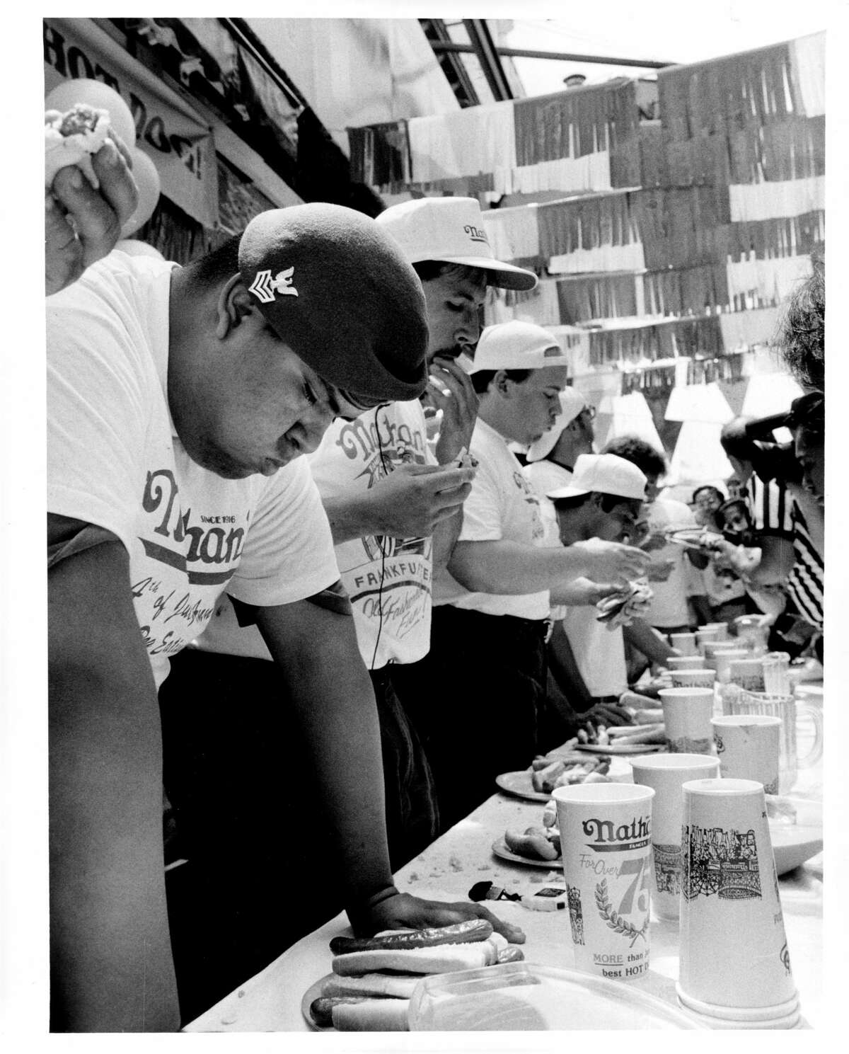 Hot dog aficionados chow down at the Nathan's July 4th hot dog eating contest in Coney Island on July 4, 1995. The annual contest has been around for decades, with the first recorded contest taking place in 1972.