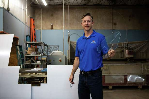 "Owner Adam Davidson poses for a portrait at Houston Custom Metal Works on July 2, 2020. Davidson has shifted his business to include custom protective screens or ""sneeze guards"" amid the coronavirus pandemic."