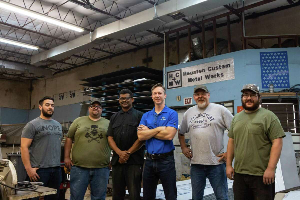 Owner Adam Davidson, center, and his shop employees pose for a portrait at Houston Custom Metal Works on July 2, 2020. Davidson has shifted his business amid the covid-19 pandemic to include custom protection screens otherwise known as