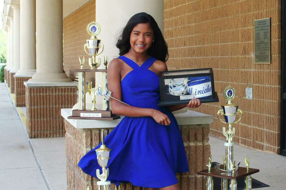 """Nevaeh Joseph, 11, of Pearland recently won the title of Texas Cinderella Miss at a pageant in Spring. She advances to the International Cinderella Pageant, which is planned for later this month in Dallas. In the talent competition at the state finals, Joseph tapped to Janelle Monáe's dance hit """"Tightrope."""" Photo: Kirk Sides / Staff Photographer / © 2020 Kirk Sides / Houston Chronicle"""