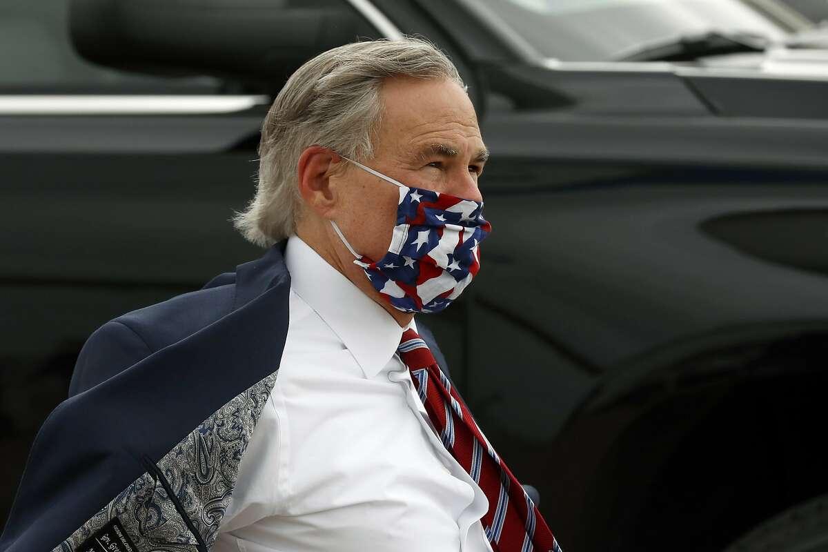 Texas Gov. Greg Abbott arrives to greet Vice President Mike Pence at Love Field in Dallas, Sunday, June 28, 2020. (AP Photo/Tony Gutierrez)